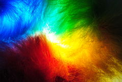 Glowing Plastic Feather. A glowing colorful plastic feather in the dark Stock Images