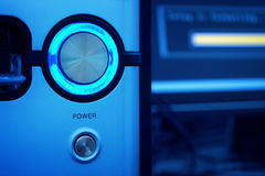 Glowing power button of computer Royalty Free Stock Photo