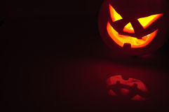 Glowing pumpkin with a candle inside Royalty Free Stock Photography