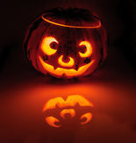 Glowing pumpkin with a candle inside Royalty Free Stock Photos
