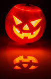 Glowing pumpkin with a candle inside Royalty Free Stock Images