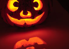 Glowing pumpkin with a candle inside Royalty Free Stock Photo