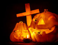 Glowing pumpkin with cross Stock Images