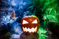 Glowing pumpkin for Halloween in witcher hut Royalty Free Stock Image