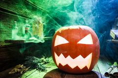 Glowing pumpkin for Halloween on wooden desk Royalty Free Stock Photo