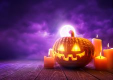 Orange Halloween Pumpkin and Purple Background Royalty Free Stock Photography