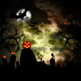 Glowing pumpkins in a dark scary forest Stock Photo