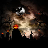Glowing pumpkins in a dark scary forest Stock Image