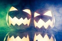 Glowing pumpkins and smoke for Halloween Stock Image