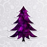 Glowing purple Christmas tree isolated on the white background. Stock Image