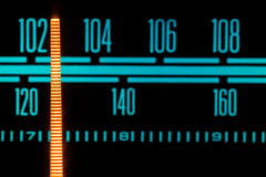 Glowing radio with the marker running through the different stations and frequencies Stock Image