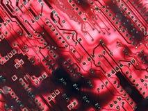 Glowing red circuits. Back lit red circuit board macro stock photo