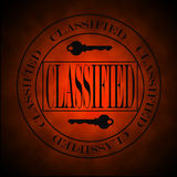 Glowing Red Classified Symbol or Stamp Stock Images