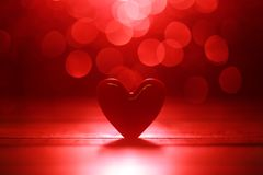 Glowing red hearts background Stock Photography