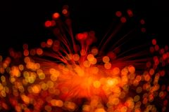 Glowing red optical fibers. Abstraction stock photos