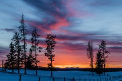 Red sky at night, sunset, Cowboy Trail, Alberta, Canada. A glowing red sky sets of the night and brings an end to a great day Stock Photo
