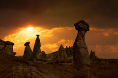 Glowing red sunset with silhouettes of mushroom rocks in Cappado Royalty Free Stock Image