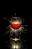 Glowing red wine and firework Stock Photography