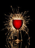 Glowing red wine and firework Royalty Free Stock Image