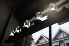 Glowing retro light bulbs in the dark. Stock photo Stock Image