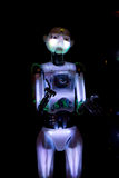 A glowing robot stretching out its hands Stock Image