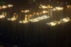 Glowing roofs of residential highrises in foggy Guangzhou, China Stock Image