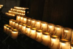 Glowing row of votive candles,Notre Dame Cathedral, Paris Stock Images