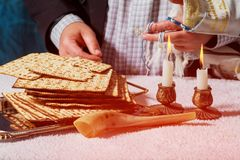 Glowing Sabbath candles. Selective focus closeup on two wax candles passover matzah. Glowing Sabbath candles Selective focus closeup on two wax candles in Stock Image