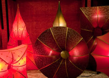 Glowing silk lamps. Unusual shaped silk lampshades in red and burgundy colours glowing stock photography