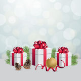Glowing silver bokeh background and christmas gift boxes with decoration ball. Glowing bokeh background and christmas gift boxes Stock Images