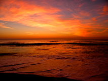 Glowing skies over the ocean Stock Images