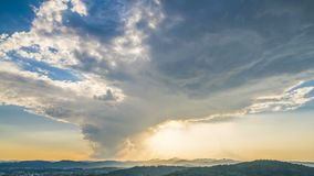 Glowing sky with clouds flying above mountains, heavenly sunrise, timelapse stock video