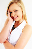 Glowing smile. Young female model smiling at the camera a little bashful Royalty Free Stock Photo