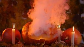 Glowing smoking monster pumpkin. Halloween concept stock video footage