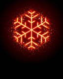 Glowing Snowflake. Red, glowing snowflake on black with sparkles Royalty Free Stock Photo