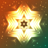 Glowing snowflake on orange and green gradient background with sparkles Royalty Free Stock Photo