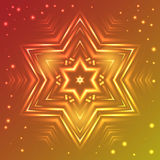 Glowing snowflake on red and yellow gradient background with sparkles Stock Photos