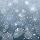 Glowing snowflakes blue bokeh Stock Images