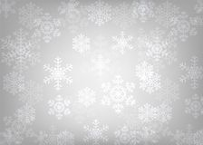 Glowing snowflakes. Christmas silver background with glowing snowflakes and bokeh Stock Image