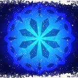 Glowing snwoflake on blue Stock Photography