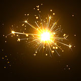 Glowing, Sparkling and Blistering Sparkler on Dark Brown Royalty Free Stock Image
