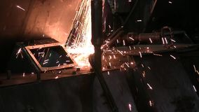 Industry worker cutting metal with grinder. Glowing sparks at metal sawing. Industry worker cutting metal with grinder stock video footage