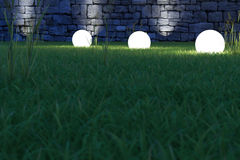 Glowing spheres low angle. Glowing spheres in garden by night backyard Stock Image