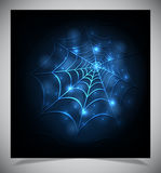 Glowing spider web on a dark background Stock Images