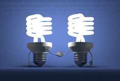 Glowing spiral light bulb characters handshaking Royalty Free Stock Photo