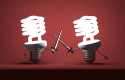 Glowing spiral light bulbs fighting duel with swords. Glowing fluorescent light bulbs fighting duel with swords on red textured background Stock Images