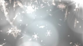 Glowing spots of light against snowflakes falling on grey background