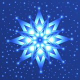 Glowing star on blue background with sparkles Stock Image