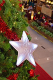 Glowing Star Christmas Decoration. With restaurant in the background. Christmas season is a time to share joy within family and also used for commercial stock photos