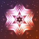 Glowing star on dark gradient background with sparkles Stock Photography